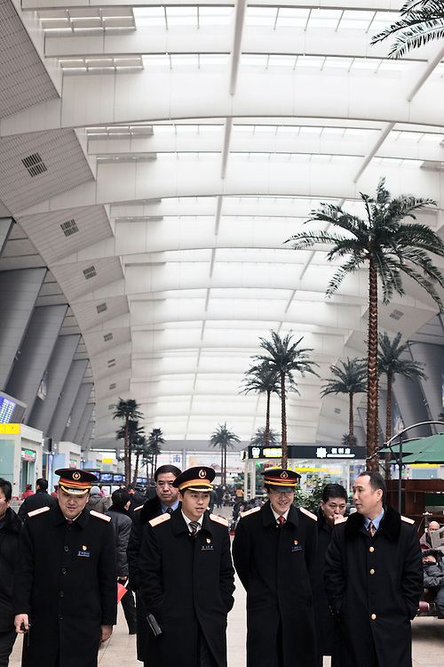 Train staff at Beijing South Railway station where the high speed trains to Tianjin depart from.