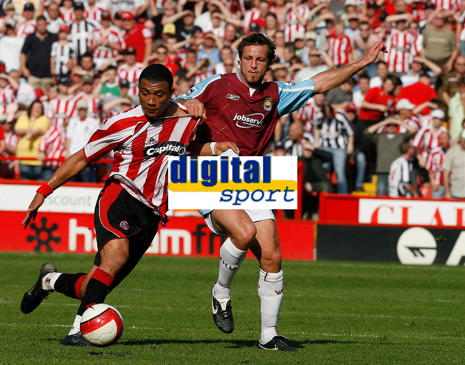 Photo: Paul Greenwood.<br />Sheffield United v West Ham United. The Barclays Premiership. 14/04/2007.<br />West Ham's Lucas Neill, (R) looses out to Colin Kazim-Richards