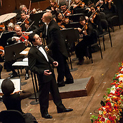 """November 11, 2012 - New York, NY : Accompanied by members of the Metropolitan Opera Orchestra and The New York Choral Society, and conducted by Patrick Summers, tenor Giuseppe Filianoti (standing, foreground) performs Giuseppe Verdi's """"Quando le sera al placido"""" from Luisa Miller during the 2012 Richard Tucker Gala and concert in Lincoln Center's Avery Fisher Hall on Sunday evening. CREDIT: Karsten Moran for The New York Times"""