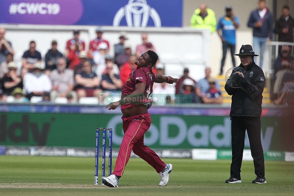 July 1, 2019 - Chester Le Street, County Durham, United Kingdom - West Indies' Oshane Thomas bowling and umpire Bruce Oxenford wearing an armguard during the ICC Cricket World Cup 2019 match between Sri Lanka and West Indies at Emirates Riverside, Chester le Street on Monday 1st July 2019. (Credit Image: © Mi News/NurPhoto via ZUMA Press)