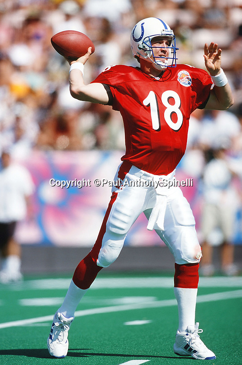 AFC Indianapolis Colts quarterback Peyton Manning (18) throws a pass during the NFL Pro Bowl Football game against the NFC on Feb. 6, 2000 in Honolulu. The NFC won the game 51-31. (©Paul Anthony Spinelli)