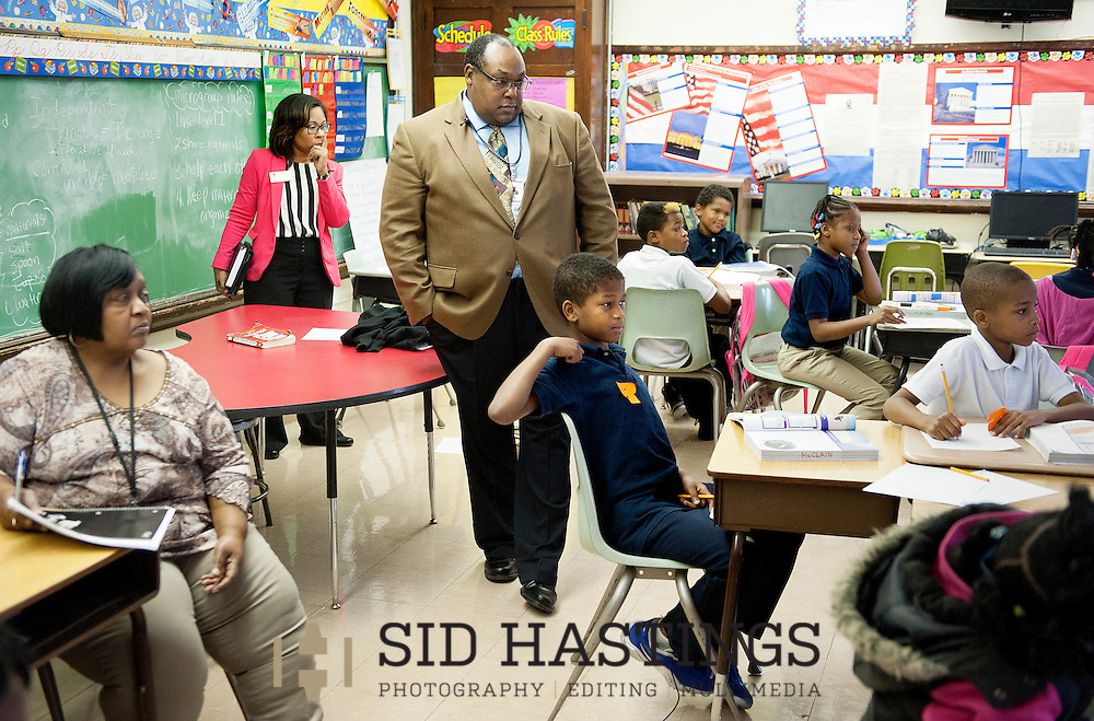 16 Sept. 2013 -- BEL-NOR, Mo. -- Normandy School District superintendent Dr. Ty McNichols (center) and assistant superintendent of school Candice Carter-Oliver monitor a class at Bel-Nor Elementary School in Bel-Nor, Mo. Monday, Sept. 16, 2013. The school is part of the Normandy School District in suburban St. Louis, which currently lacks state accreditation and has seen a substantial number of students transfer to other districts for school year 2013-14. Photo © copyright 2013 Sid Hastings.