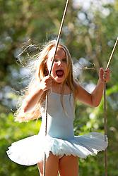 Young Girl on Swing Shouting