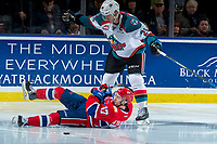 KELOWNA, CANADA - MARCH 3:  Kailer Yamamoto #17 of the Spokane Chiefs falls to the ice in front of Cal Foote #25 of the Kelowna Rockets on March 3, 2018 at Prospera Place in Kelowna, British Columbia, Canada.  (Photo by Marissa Baecker/Shoot the Breeze)  *** Local Caption ***