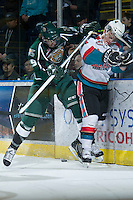KELOWNA, CANADA - DECEMBER 30:  Carter Rigby #11 of the Kelowna Rockets is checked by Austin Adam #29 of the Everett Silvertips at the Kelowna Rockets on December 30, 2012 at Prospera Place in Kelowna, British Columbia, Canada (Photo by Marissa Baecker/Shoot the Breeze) *** Local Caption ***