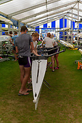 "Henley on Thames, United Kingdom, 29th June 2018, Friday, ""Henley Royal Regatta"", Qualifying races, [Time Trails] Crews Relax,Reading University, ""rig and prepare, their boat, before they race, over the, Regatta Course, Henley Reach, River Thames, Thames Valley, England, © Peter SPURRIER, 29/06/2018"