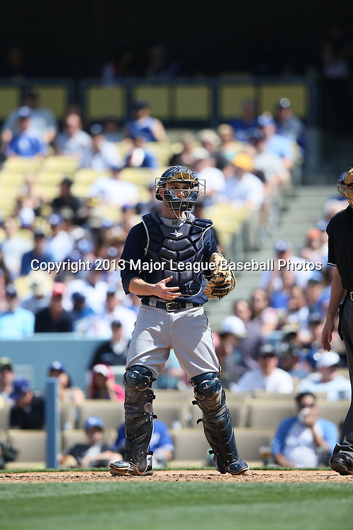 LOS ANGELES, CA - APRIL 28:  Jonathan Lucroy #20 of the Milwaukee Brewers catches during the game against the Los Angeles Dodgers on Sunday, April 28, 2013 at Dodger Stadium in Los Angeles, California. The Dodgers won the game 2-0. (Photo by Paul Spinelli/MLB Photos via Getty Images) *** Local Caption *** Jonathan Lucroy