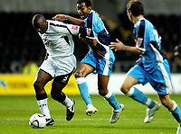 Photo: Adam Davies.<br />Swansea City v Wycombe Wanderers. Carling Cup. 22/08/2006.<br />Swansea's Kevin Austin takes the ball from Wycombe's Kevin Besty.