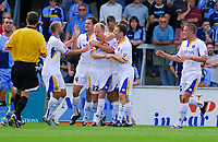 Photo: Leigh Quinnell.<br /> Wycombe Wanderers v Shrewsbury. Coca Cola League 2. 22/09/2007. Shrewsbury players congratulate Colin Murdock (22) after his goal.