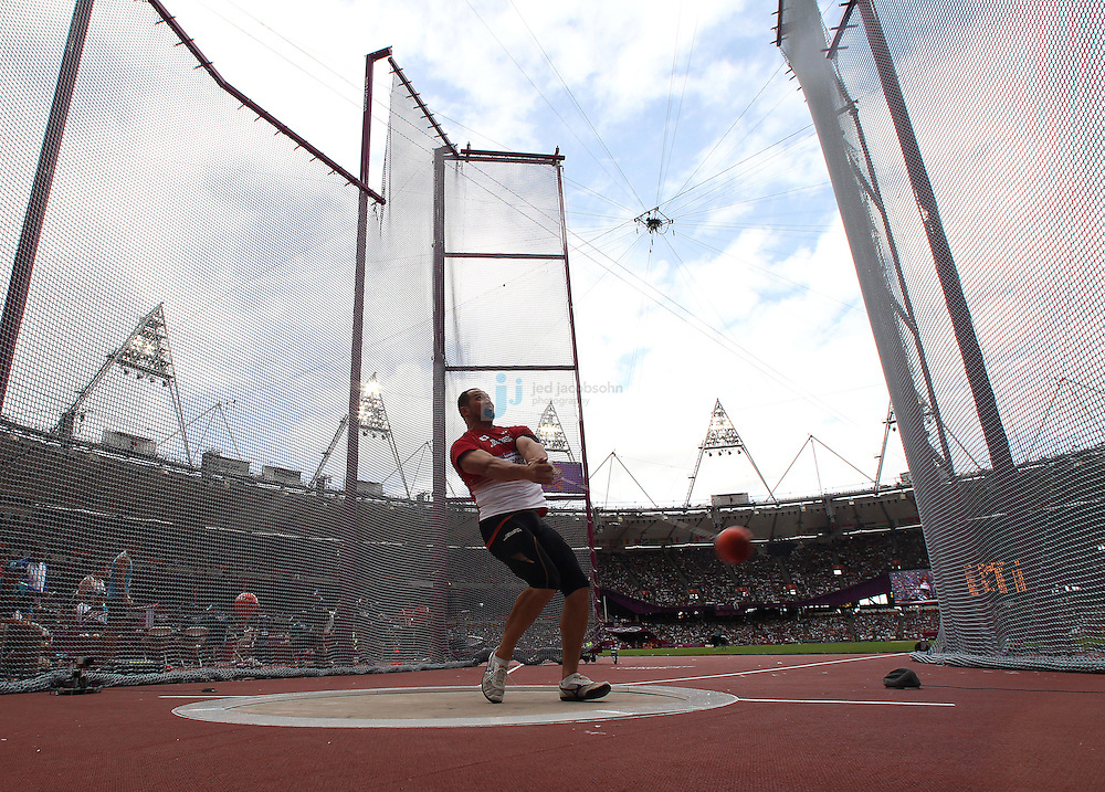 Koji Murofushi of Japan throws during the men' s hammer throw qualification round during the track and field event at the Olympic Stadium during day 6 of the London Olympic Games in London, England, United Kingdom on August 3, 2012..(Jed Jacobsohn/for The New York Times)..