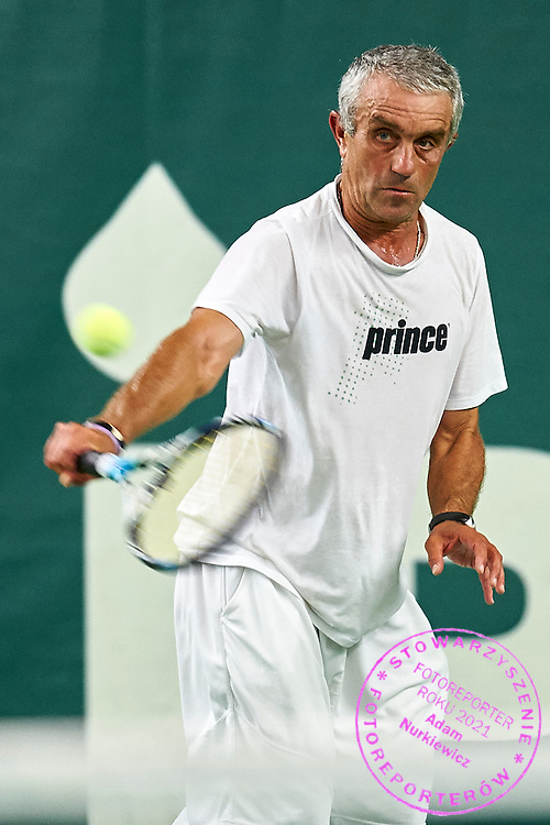 Helsinki, Finland - 2016 June 25: Plamen Tsonev from Bulgaria in action while MS50 - Singles Main Draw match during 36th ITF Seniors World Individual Championships 2016 at Talin Tenniskeskus on June 25, 2016 in Helsinki, Finland.<br /> <br /> Adam Nurkiewicz declares that he has no rights to the image of people at the photographs of his authorship.<br /> <br /> Picture also available in RAW (NEF) or TIFF format on special request.<br /> <br /> Any editorial, commercial or promotional use requires written permission from the author of image.<br /> <br /> Mandatory credit:<br /> Photo by &copy; Adam Nurkiewicz