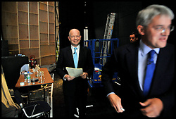 Foreign Secretary William Hague waits backstage at the Conservative Party Conference in Manchester, moments before delivering his speech as the International Development Secretary Andrew Mitchell rushes past, Sunday October 2,  2011 Photo By Andrew Parsons/ i-Images