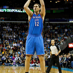 January 24,  2011; New Orleans, LA, USA; Oklahoma City Thunder center Nenad Krstic (12) against the New Orleans Hornets during the fourth quarter at the New Orleans Arena. The Hornets defeated the Thunder 91-89. Mandatory Credit: Derick E. Hingle
