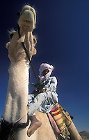 Tuareg and his camel, Algeria