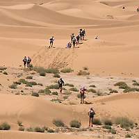 25 March 2007:  Participants run across small dunes between Irhs and Khermou during the first stage of  the 22nd Marathon des Sables, a 6 days and 151 miles endurance race with food self sufficiency across the Sahara Desert in Morocco. Each participant must carry his, or her, own backpack containing food, sleeping gear and other material.
