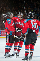 KELOWNA, CANADA - MARCH 15: Dalton Yorke #5 and Nick Merkley #10 congratulate Madison Bowey #4 of the Kelowna Rockets on the first goal of the game against the Vancouver Giants during the first period on March 15, 2014 at Prospera Place in Kelowna, British Columbia, Canada.   (Photo by Marissa Baecker/Getty Images)  *** Local Caption *** Dalton Yorke; Madison Bowey; Nick Merkley;