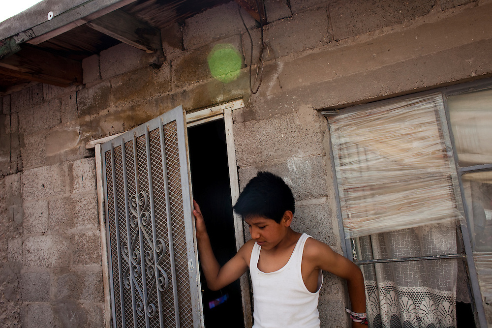 Pedro Ivan, 12, outside his home in the Diaz Ordaz colonia in Ciudad Juarez, Chihuahua Mexico on April 28, 2010.