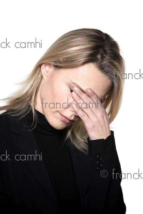 beautiful blond hair woman sad grief headache portrait on studio white isolated background
