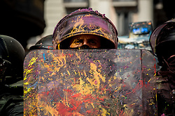 September 29, 2018 - Barcelona, Catalonia, Spain - A Catalan regional police officer (Mossos Esquadra) covered in paint looks over during a  pro-independence protest in Barcelona. Pro-independence supporters demonstrated against a march in support of Spanish police. Next first October marks one year of the Catalan referendum on independence that led hundreds of injuried voters due the Spanish police crackdown. (Credit Image: © Jordi Boixareu/ZUMA Wire)