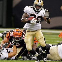 2009 August 14: New Orleans Saints running back Lynell Hamilton (30) runs away from Cincinnati Bengals linebacker Chris Harrington (96) during 17-7 win by the New Orleans Saints over the Cincinnati Bengals in their preseason opener at the Louisiana Superdome in New Orleans, Louisiana.