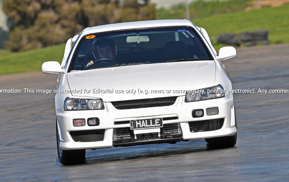Daniel Hall..Nissan Skyline R34 GTT.SAU Deca Motorkhana sponsored by Micolour.Shepparton, Victoria .15th of August 2009.(C) Joel Strickland Photographics.Use information: This image is intended for Editorial use only (e.g. news or commentary, print or electronic). Any commercial or promotional use requires additional clearance.