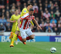 Stoke City's Jonathan Walters is fouled by Tottenham Hotspur's Vlad Chiriches - Photo mandatory by-line: Dougie Allward/JMP - Mobile: 07966 386802 - 09/05/2015 - SPORT - Football - Stoke - Britannia Stadium<br />  - Stoke v Tottenham Hotspur - Barclays Premier League