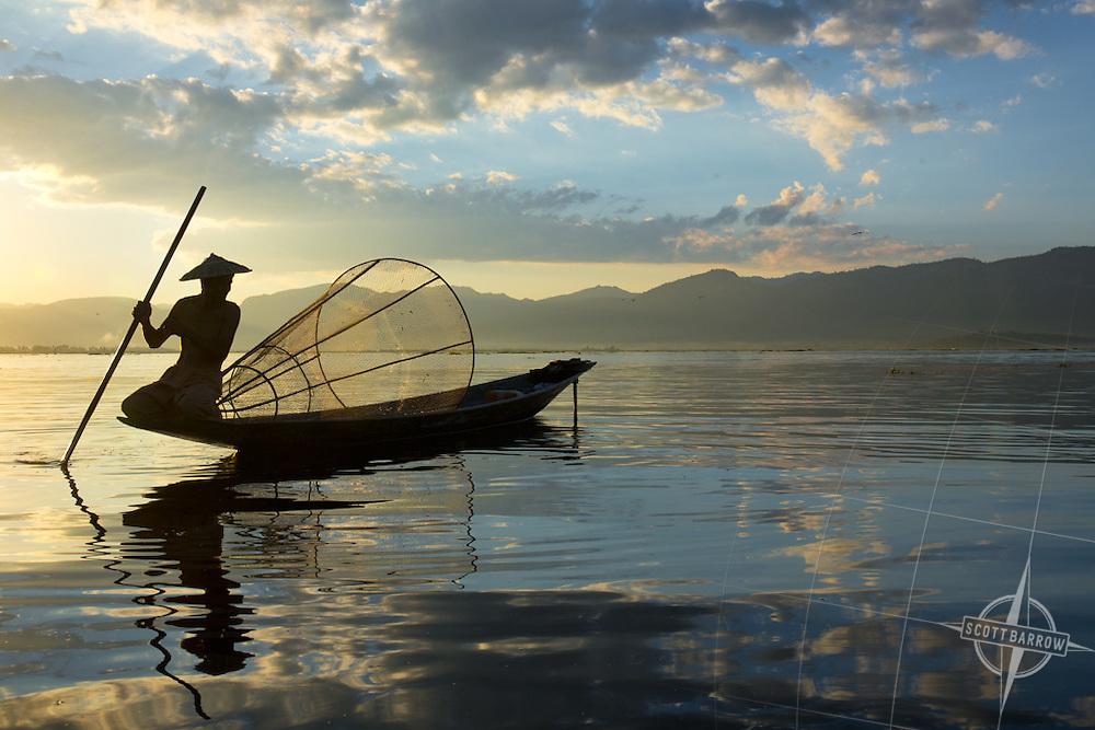Fishermen on Inle Lake in Myanmar at sunset.