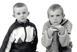 Studio portrait of two boys UK 1990s