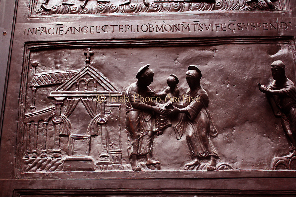 Detail from Bronze doors with scenes from the Old and New Testament in relief. Made at the order of St. Bernward, and set up by him in 1015 at St. Michael's Church, Hildesheim. They were since taken to the cathedral by his successor. This panel shows the Presentation to Simeon.