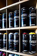 Cans of Evolve spray paint in Wynwood's Graffiti Supply Shop -- Home of Evolve Paints