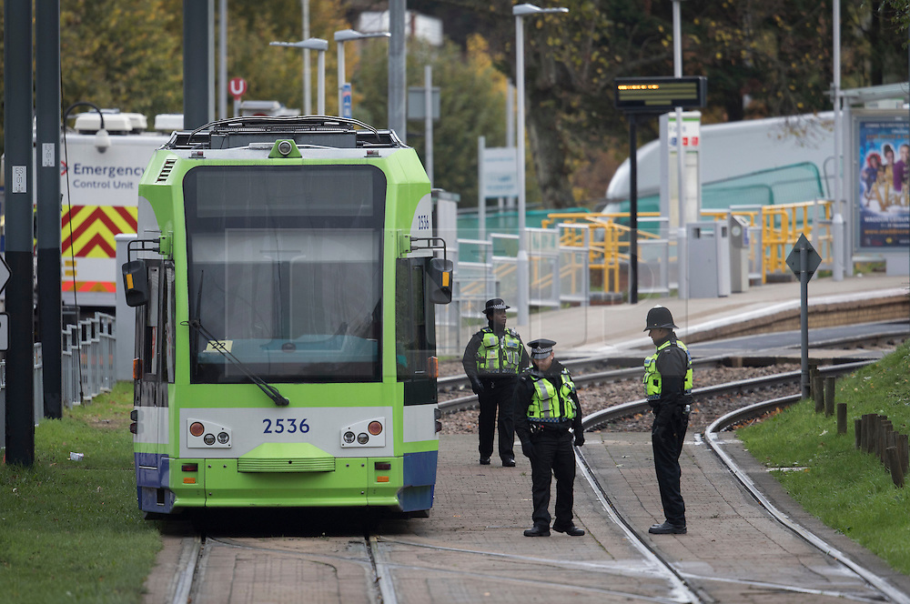© Licensed to London News Pictures. 10/11/2016. Croydon, UK. Police stand near a tram just outside Sandilands tram station as investigations are continuing into a tram crash that police say claimed seven lives and injured 50. The driver has been arrested and is being questioned by police. Photo credit: Peter Macdiarmid/LNP