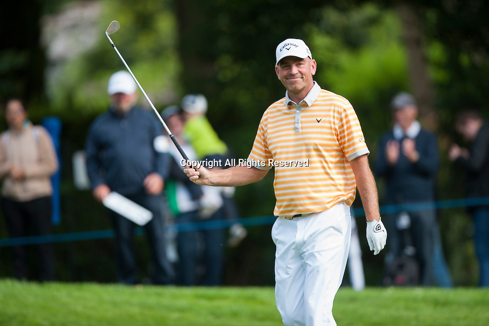 23.05.2014. Wentworth, England. Thomas BJORN [DEN] acknowledges the crowd after chipping in from the bunker on the 15th for a birdie to go -9 during the second round of the 2014 BMW PGA Championship from The West Course Wentworth Golf Club