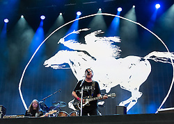 "© Licensed to London News Pictures. 12/07/2014. London, UK.   Neil Young and Crazy Horse performing live at Hyde Park as part of the British Summer Time series of outdoor concerts.   Crazy Horse is a rock band long associated with Neil Young,  consisting of members Rick Roses, (bass, vocals), Ralph Molina (drums, vocals), Frank ""Poncho"" Sampedro ( guitar, organ, keyboards).  Photo credit : Richard Isaac/LNP"