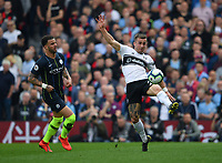 Football - 2018 / 2019 Premier League - Fulham vs. Manchester City<br /> <br /> Fulham's Joe Bryan shields the ball from Manchester City's Kyle Walker, at Craven Cottage.<br /> <br /> COLORSPORT/ASHLEY WESTERN