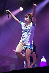 Image ©Licensed to i-Images Picture Agency . 18/07/2014 . Henham Park , Suffolk , United Kingdom . LILY ALLEN performs on the Obelisk ( Main ) stage . She stepped in to replace Two Door Cinema Club , who were unable to perform due to staff illness . The Latitude Festival of music and arts . Picture by Joel Goodman/i-Images