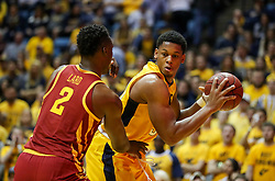 Feb 24, 2018; Morgantown, WV, USA; West Virginia Mountaineers forward Sagaba Konate (50) looks to make a move around Iowa State Cyclones forward Cameron Lard (2) during the second half at WVU Coliseum. Mandatory Credit: Ben Queen-USA TODAY Sports