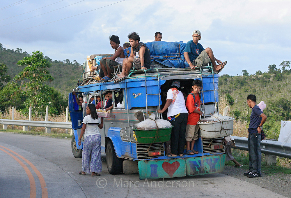 A jeepney loaded with passengers, Philippines