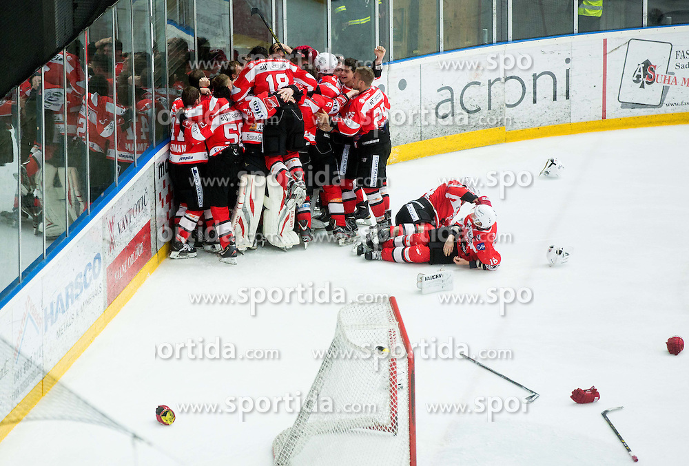 Players of Jesenice celebrate after winning during ice-hockey match between HDD SIJ Acroni Jesenice and HDD Telemach Olimpija in 4th leg of Finals of Slovenian National Championship 2014/15 and became Slovenian Champions 2015, on April 15, 2015 in Arena Podmezakla, Jesenice, Slovenia. Photo by Vid Ponikvar / Sportida