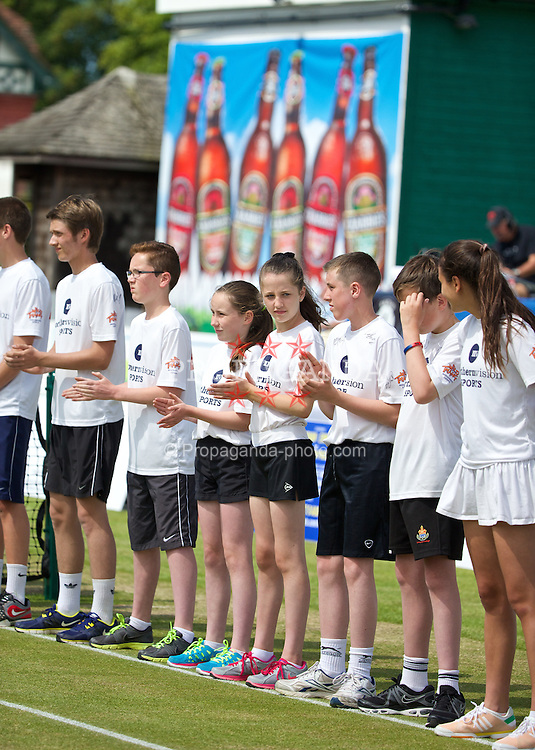 LIVERPOOL, ENGLAND - Saturday, June 21, 2014: Ball girls and boys during Day Three of the Liverpool Hope University International Tennis Tournament at Liverpool Cricket Club. (Pic by David Rawcliffe/Propaganda)
