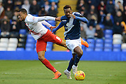 Birmingham City midfielder Jacques Maghoma skips past Charlton Athletic midfielder Jordan Cousins during the Sky Bet Championship match between Birmingham City and Charlton Athletic at St Andrews, Birmingham, England on 21 November 2015. Photo by Alan Franklin.