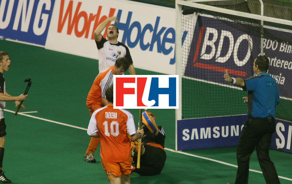 Kuala Lumpur:   Florian Keller of Germany reacts over umpire's  Simmonds Gary in the closing moments of the match against Netherlands in the Samsung Hockey Men Champions Trophy at the National Stadium, Bukit Jalil, Malaysia on 05 Dec 2007. <br /> Netherlands drew with Germany 3-3.<br /> Photo:GNN/Vino John