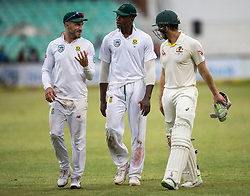 Durban. 010218. Tim Paine, Faf du Plessisand Kagiso Rabada leaves the field after bad light stopped play during the first Sunfoil Test Match played at Kingsmead in Durban. Picture Leon Lestrade/African News Agency/ANA