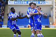 Colchester United midfielder Brennan Dickenson (11) congratulates Colchester United striker Chris Porter (9) after the first goal during the EFL Sky Bet League 2 match between Colchester United and Luton Town at the Weston Homes Community Stadium, Colchester, England on 25 March 2017. Photo by Nigel Cole