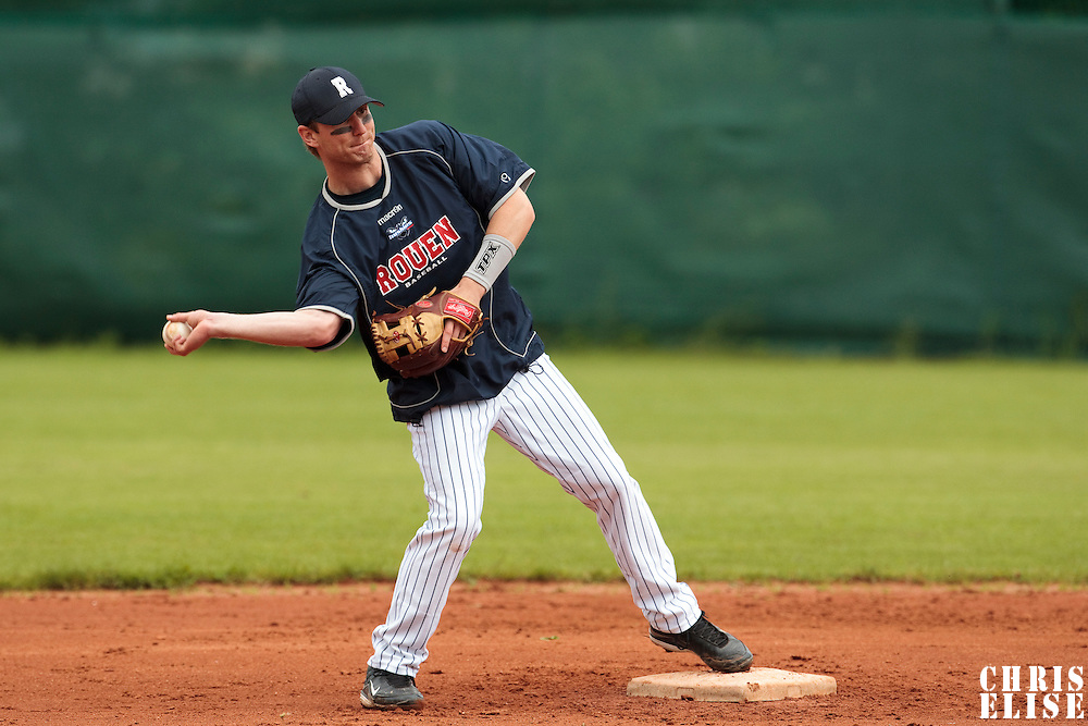 03 June 2010: Shortstop Aaron Hornostaj of Rouen takes infield practice prior to the 2010 Baseball European Cup match won  8-4 by C.B. Sant Boi over the Rouen Huskies, at the Kravi Hora ballpark, in Brno, Czech Republic.