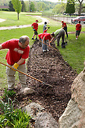John Dues (left) during a cleanup of the Victory Oak Knoll Memorial near the entrance of Dayton's Community Golf Course (at the edge of Kettering) by Boy Scout Troop 193, Saturday, May 7, 2011.