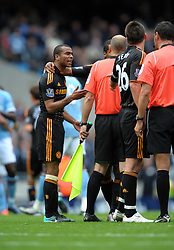 John Terry and Ashley Cole argue with referee A Marriner after the final whistle of the Barclays Premier League match between Manchester City and Chelsea at the City of Manchester Stadium on September 25, 2010 in Manchester, England.