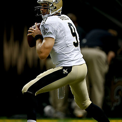 Aug 9, 2013; New Orleans, LA, USA; New Orleans Saints quarterback Drew Brees (9) against the Kansas City Chiefs during a preseason game at the Mercedes-Benz Superdome. The Saints defeated the Chiefs 17-13. Mandatory Credit: Derick E. Hingle-USA TODAY Sports