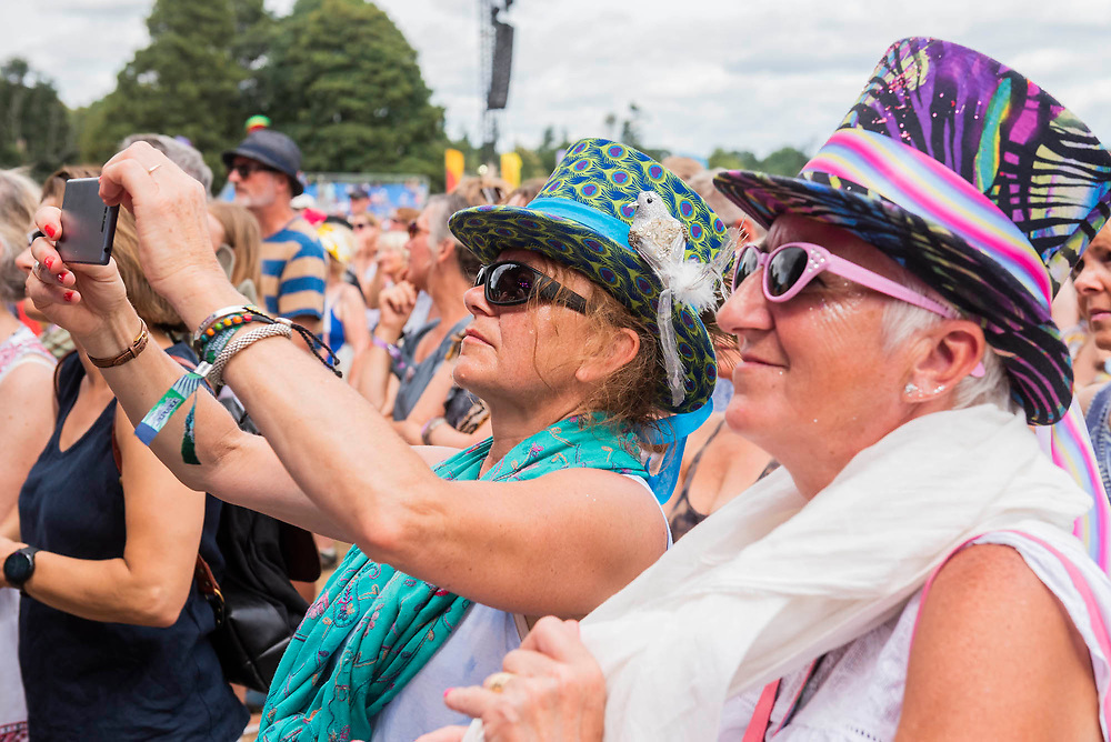 Henham Park, Suffolk, 21 July 2019. The Kingdom Choir perform on the Obelisk stage to an enrapted and lively sunday morning audience. The 2019 Latitude Festival.