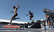Jul 27, 2019; Des Moines, IA, USA; Hillary Bor (left) defeats Stanley Kebenei (center) to win the steeplechase, 8:18.05 to 8:19.12,  during the USATF Championships at Drake Stadium. Andy Bayer aka Andrew Bayer (right) was third in 8:23.23