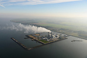 Nederland, Flevoland, Lelystad, 04-11-2018; Maximacentrale (voorheen Flevocentrale) van Engie Nederland, op een eigen kunstmatig aangelegd eiland in het IJsselmeer. Twee nieuwe stoom- en gaseenheden (STEG) met aardgas als brandstof, relatief schoon en met hoog-rendement.<br /> Naast de centrale het nieuw aangelegde zonnepark met zonnecollectoren, op de plaats van de oude centrale.<br /> Maxima power plant (formerly Flevocentrale) of Electrabel, on its own artificial island in the IJsselmeer. Two new steam and gas units (CCGT) with natural gas as fuel, relatively clean and high-efficiency (combined cycle units).<br /> Next to the power plant, the newly constructed solar park, on the site of the old power plant.<br /> <br /> luchtfoto (toeslag op standaard tarieven);<br /> aerial photo (additional fee required);<br /> copyright&copy; foto/photo Siebe Swart